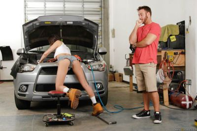 Busty brunette Ashley Adams getting screwed while fixing vehicle in garage