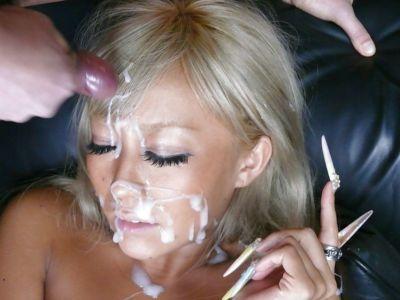 Blonde Jap chick Rina Aina taking jizz on face during bukkake session - part 2