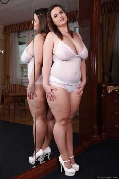 Attractive fatty with big tits Maggie B frolics in front of big mirror