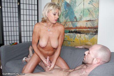 Older blonde cougar giving long dick a handjob for cumshot on tits - part 2