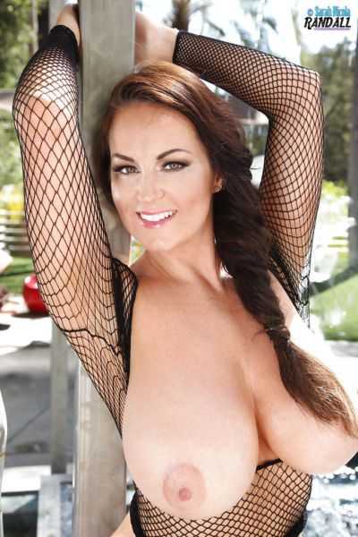 Chesty beauty Sarah Nicola Randall modeling outdoors in mesh top - part 2